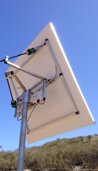 H1 Heliostat, side view - lowest cost per watt heliostat on the market offering unique advantages due its tensioned film membrane mirror.  Up to 2000 watts delivered to a target, or 230,000 lumens.